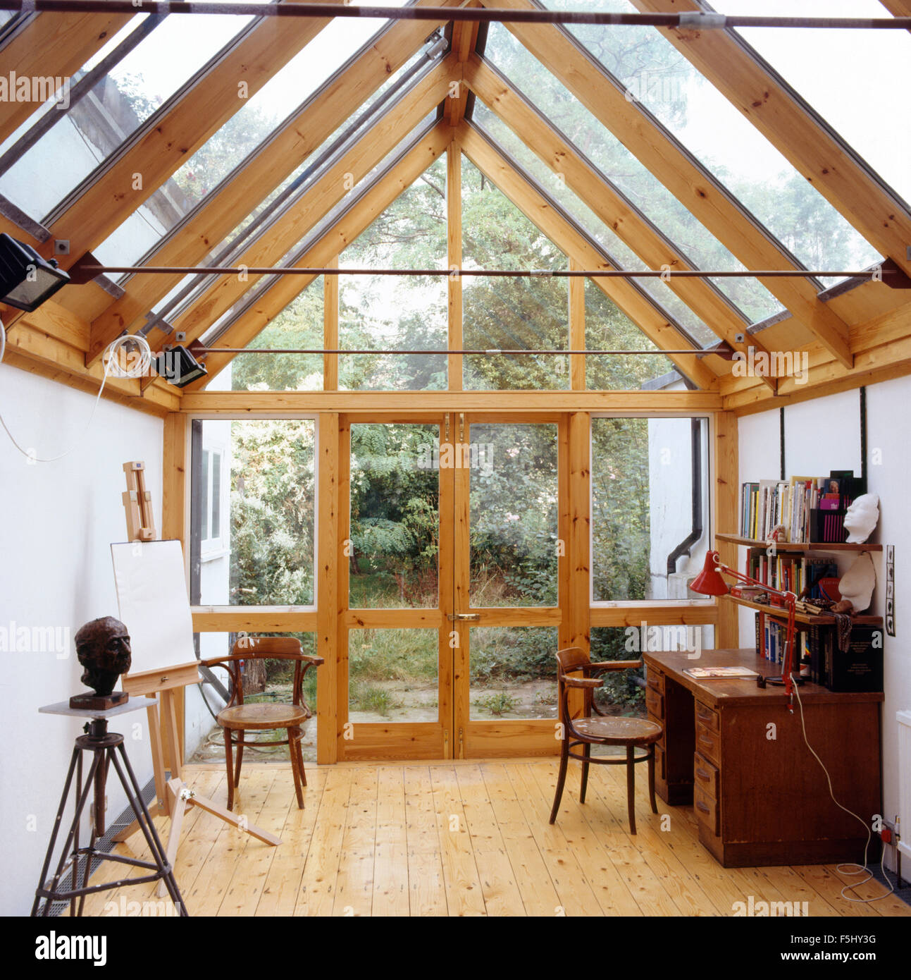 Seventies conservatory study with wooden flooring - Stock Image