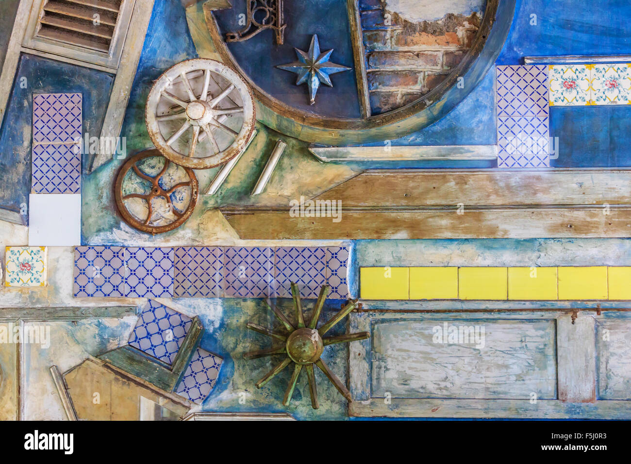 Abstract artistic installation of traditional sicilian pottery on a wall in Messina - Stock Image