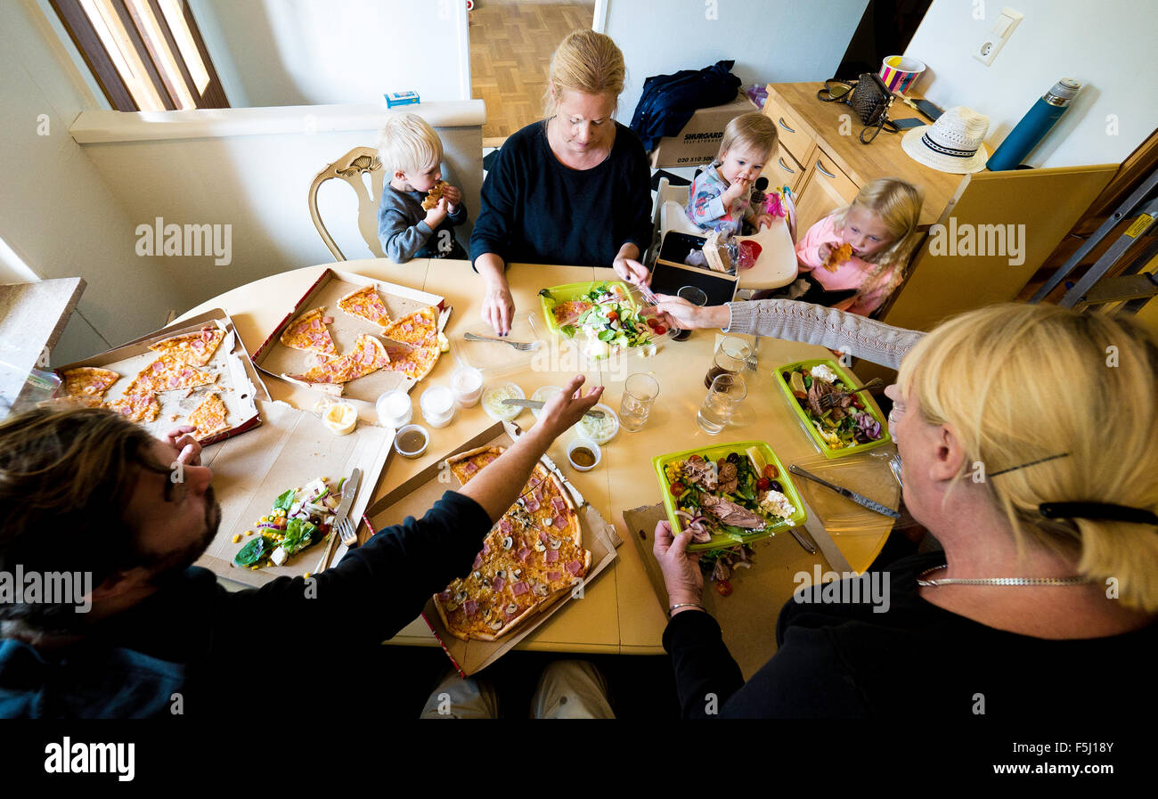 family eats pizza - Stock Image