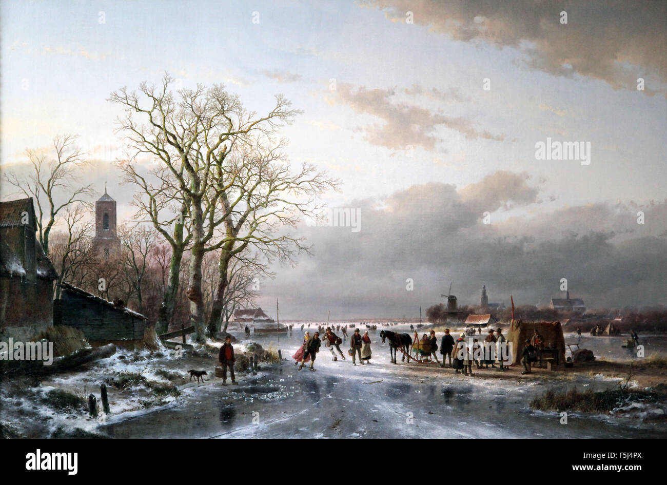 Andreas Schelfhout 1787-1870  Numerous skaters and a horse-sledge by a refreshment stall near a Dutch city 1857 - Stock Image