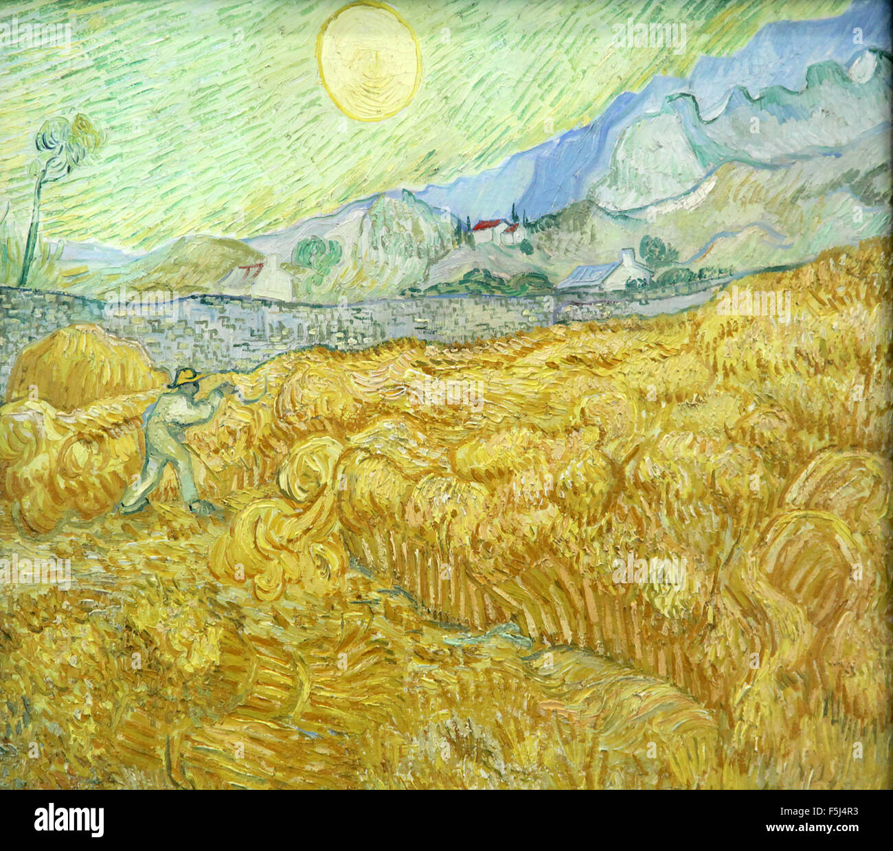 The Wheatfield behind Saint Paul's Hospital with a Reaper 1889 Vincent van Gogh 1889 - Stock Image