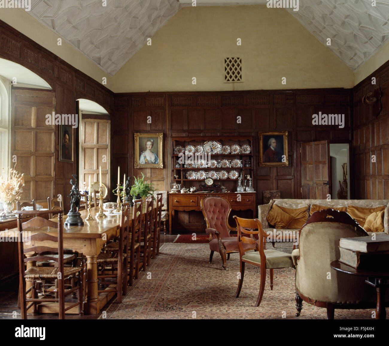 Ladder Back Chairs At A Long Table In An Old Fashioned Paneled Dining Stock Photo Alamy