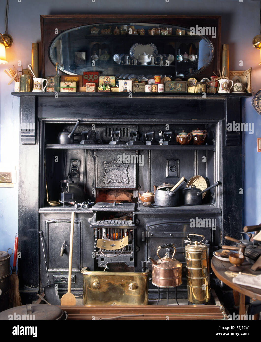 Close Up Of Copper Pans And Antique Range Oven In A