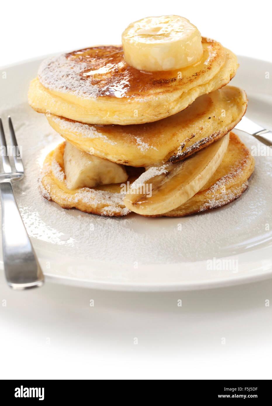 fluffy ricotta pancakes with banana isolated on white background - Stock Image