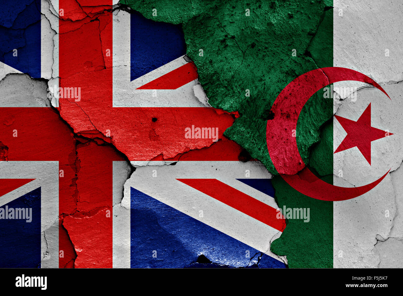 flag of UK and Algeria painted on cracked wall - Stock Image