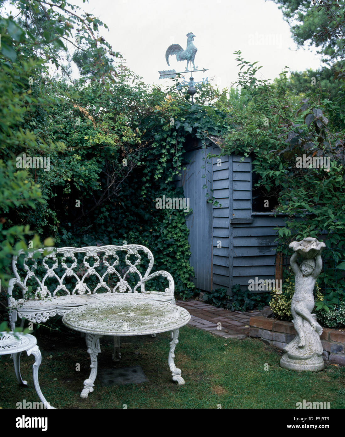 Astounding White Wrought Iron Bench And Table In Garden With A Stone Gamerscity Chair Design For Home Gamerscityorg