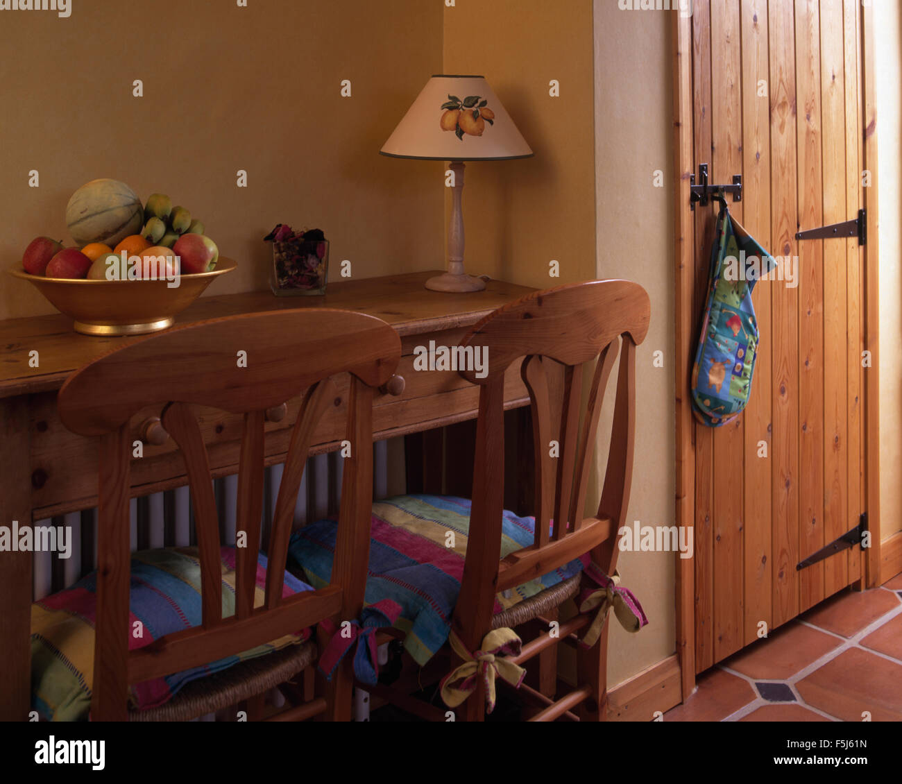 Picture of: Simple Wooden Chairs And Small Dining Table In A Cottage Dining Room Stock Photo Alamy