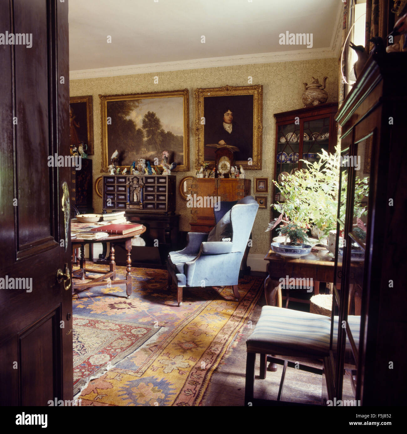 Study dining room with oil paintings and antique furniture in a Jacobean rectory Stock Photo