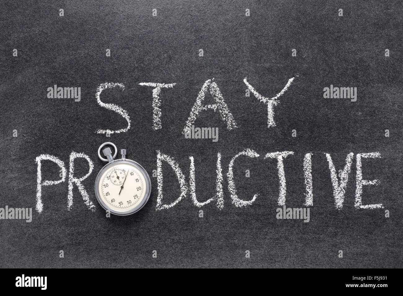 stay productive phrase handwritten on chalkboard with vintage precise stopwatch used instead of O - Stock Image