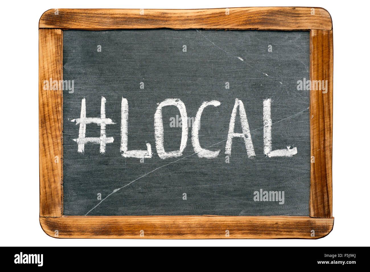 local hashtag handwritten on vintage school slate board - Stock Image