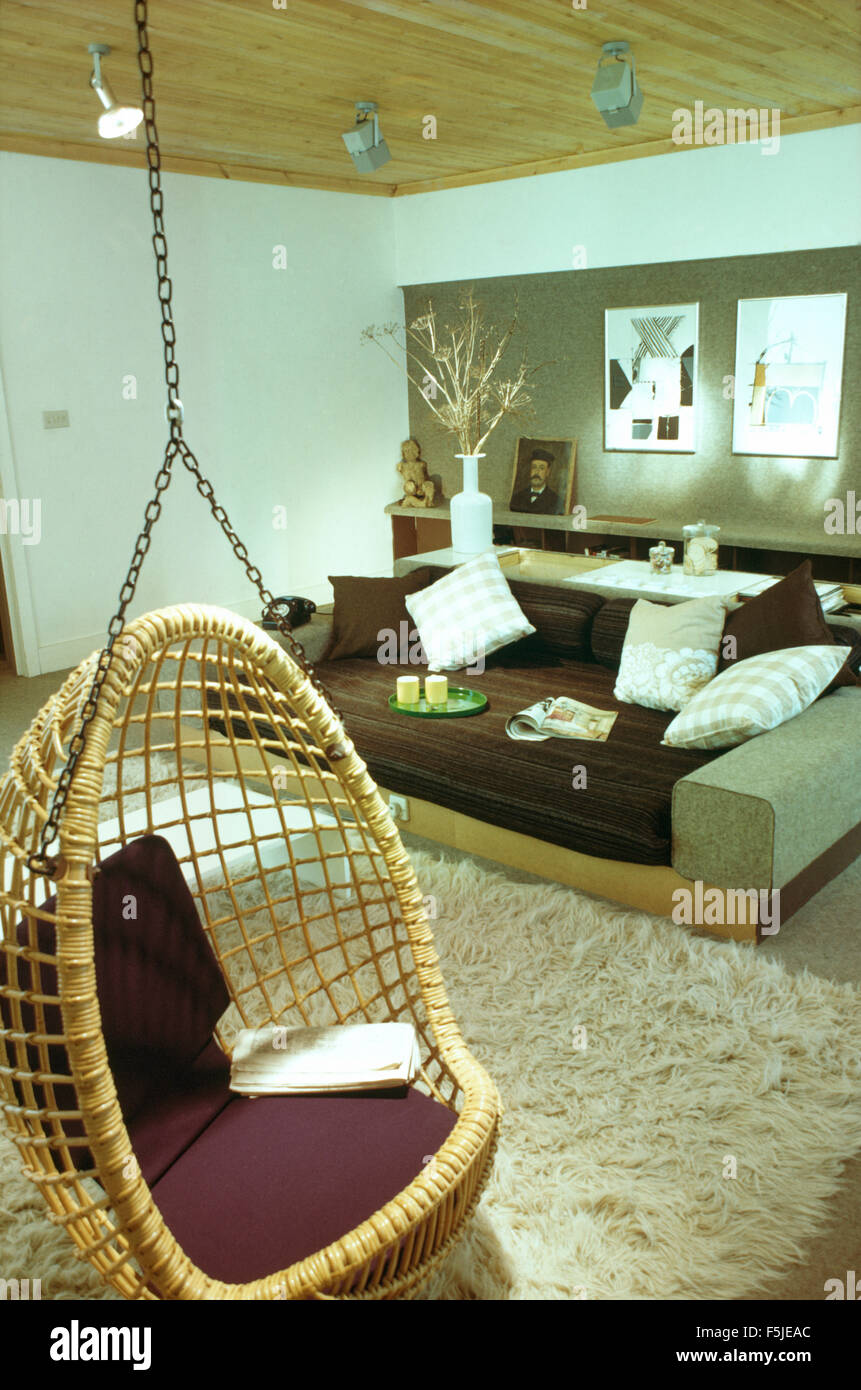 Wicker Hanging Chair In A Sixties Living Room With A Shag Pile Rug