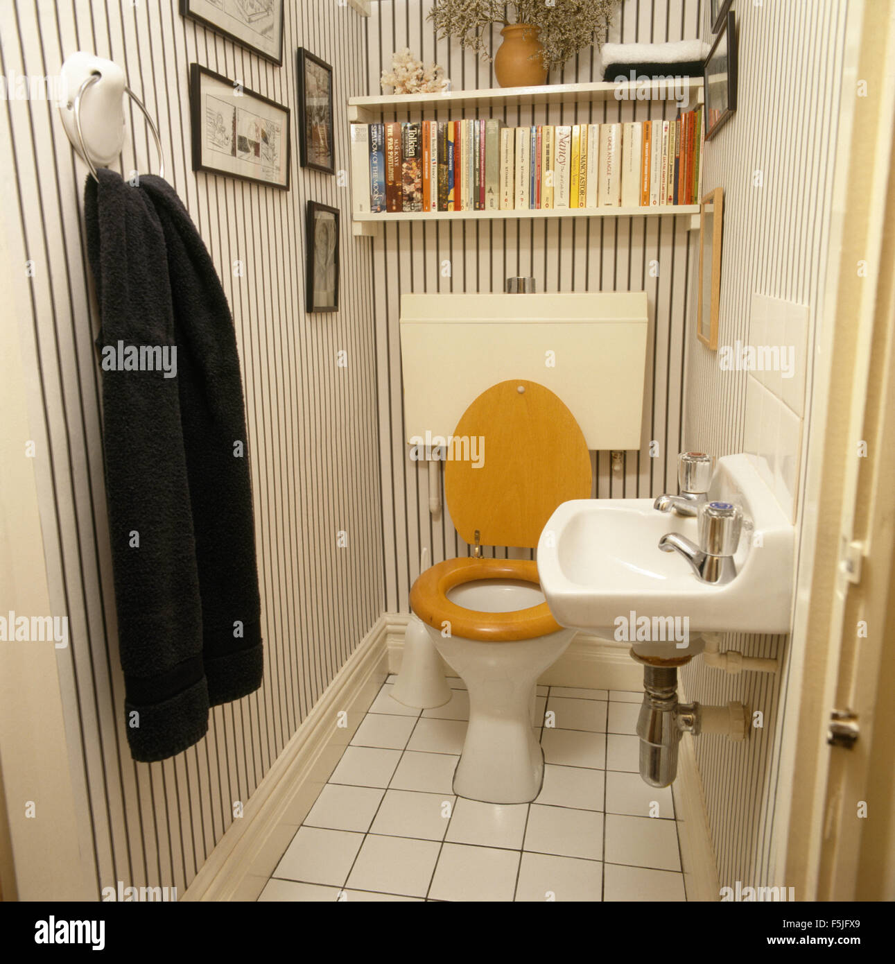 Striped wallpaper in seventies cloakroom with shelving above toilet ...