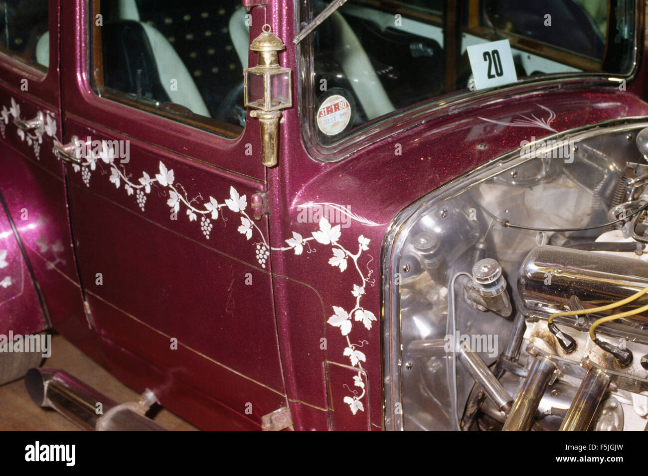 Close-up of a highly decorated pink vintage car Stock Photo