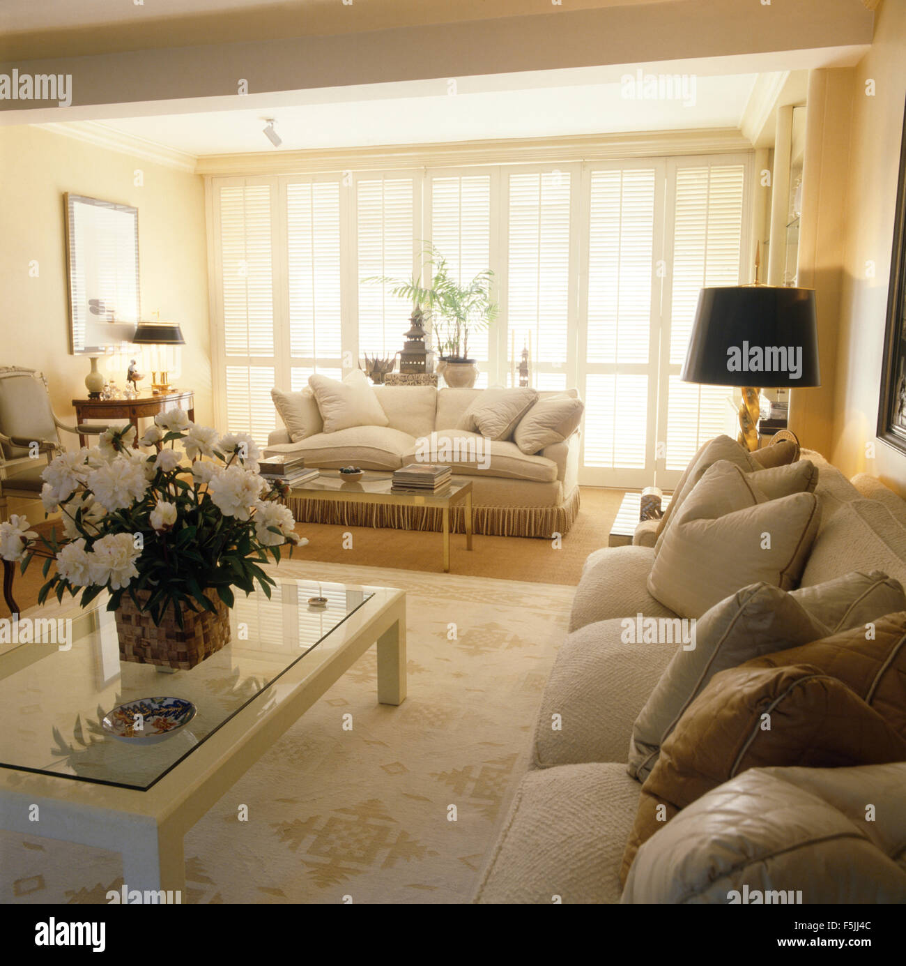 Cream Coffee Table And Cream Sofas In An Eighties Living