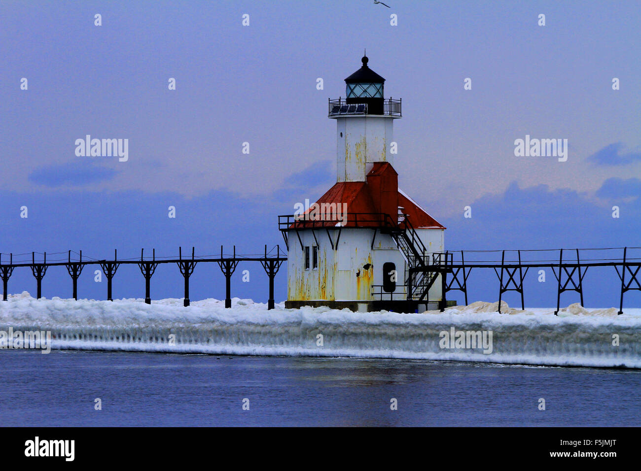 Beautiful winter scene the with St Joseph lighthouse covered in