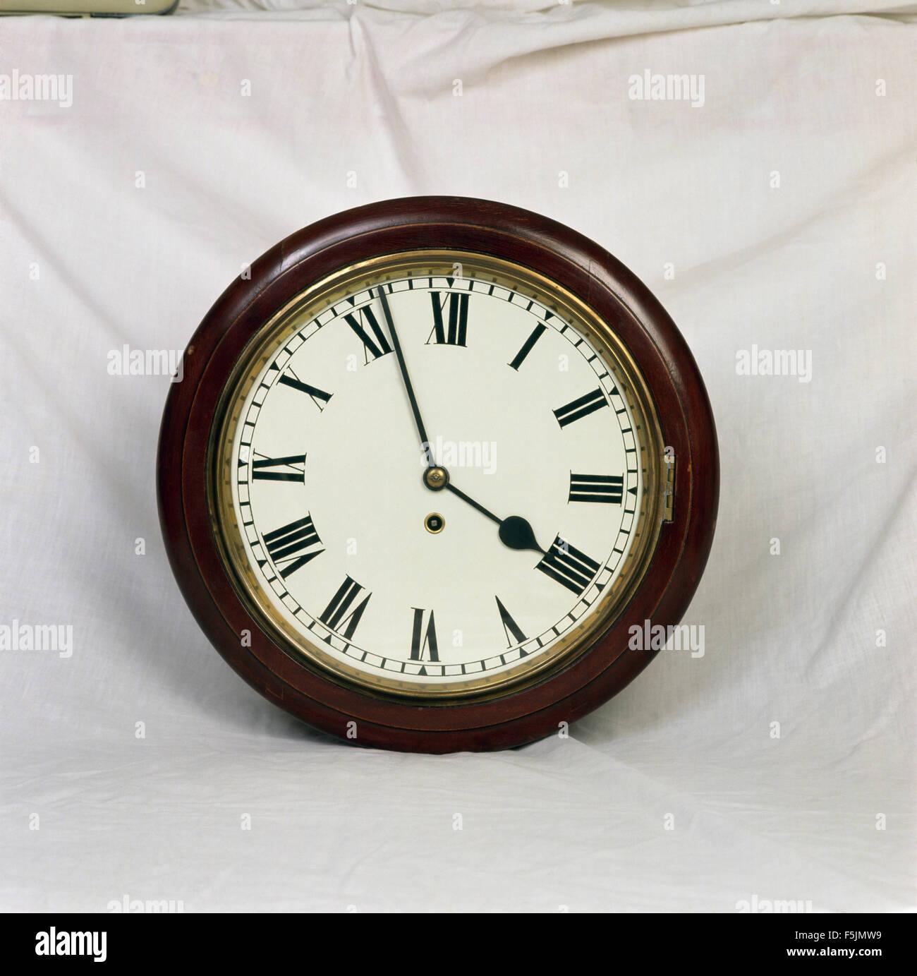 Close-up of a traditional circular wall clock - Stock Image