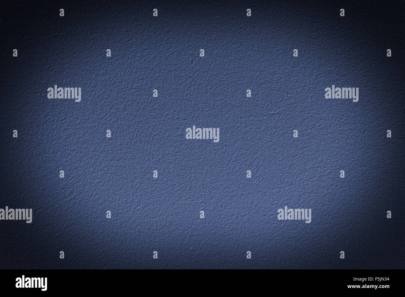 Navy blue wall with vignette, a background or texture - Stock Image