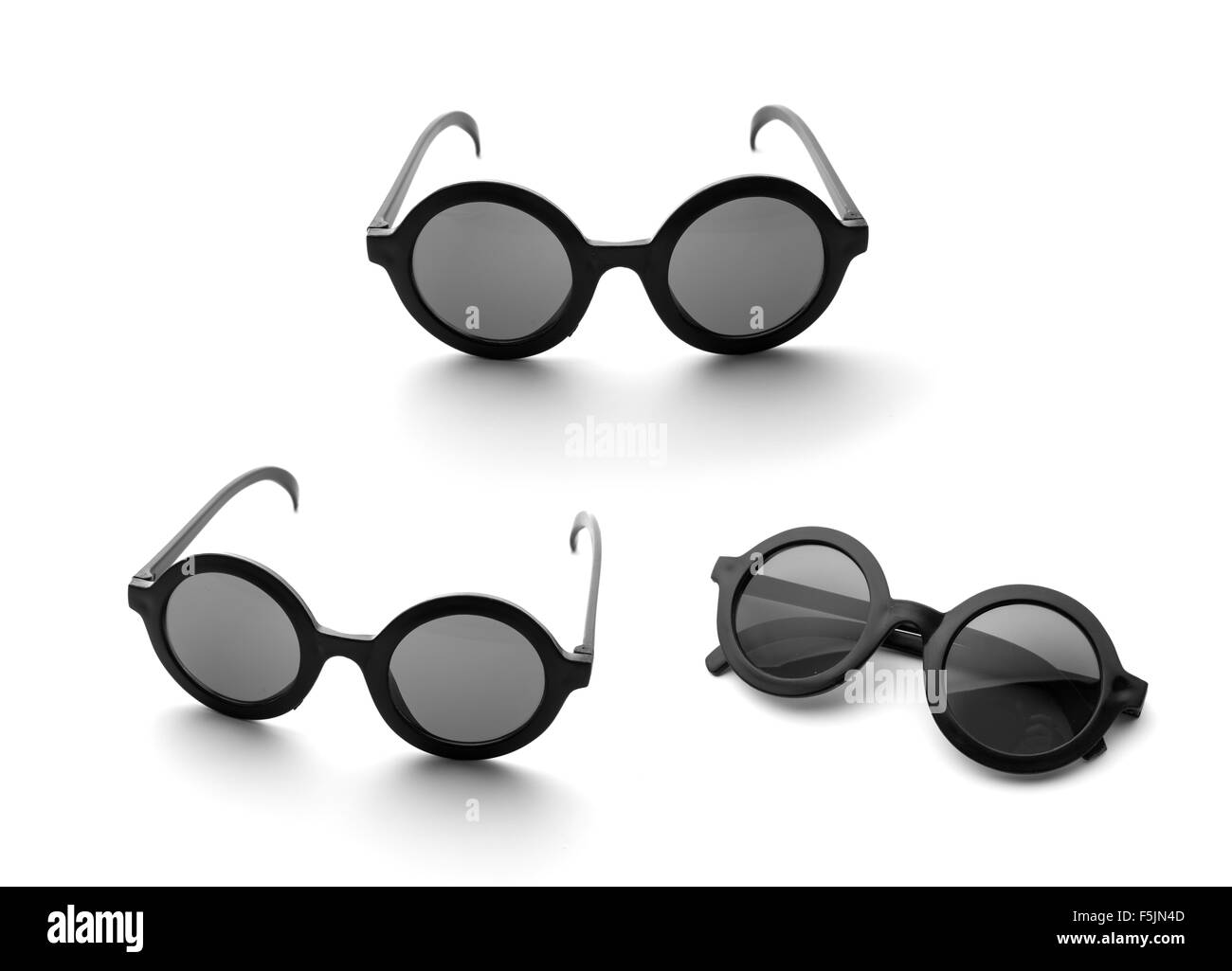 35f7ab0cb66 Three pairs of black round glasses isolated on white background - Stock  Image