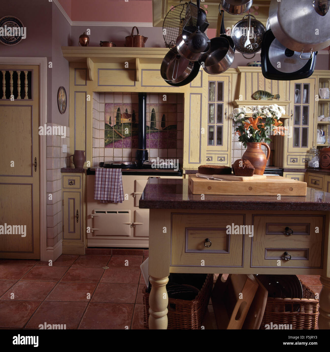 Stainless Steel Pans On Rack Above Island Unit In A Country Kitchen Stock Photo Alamy