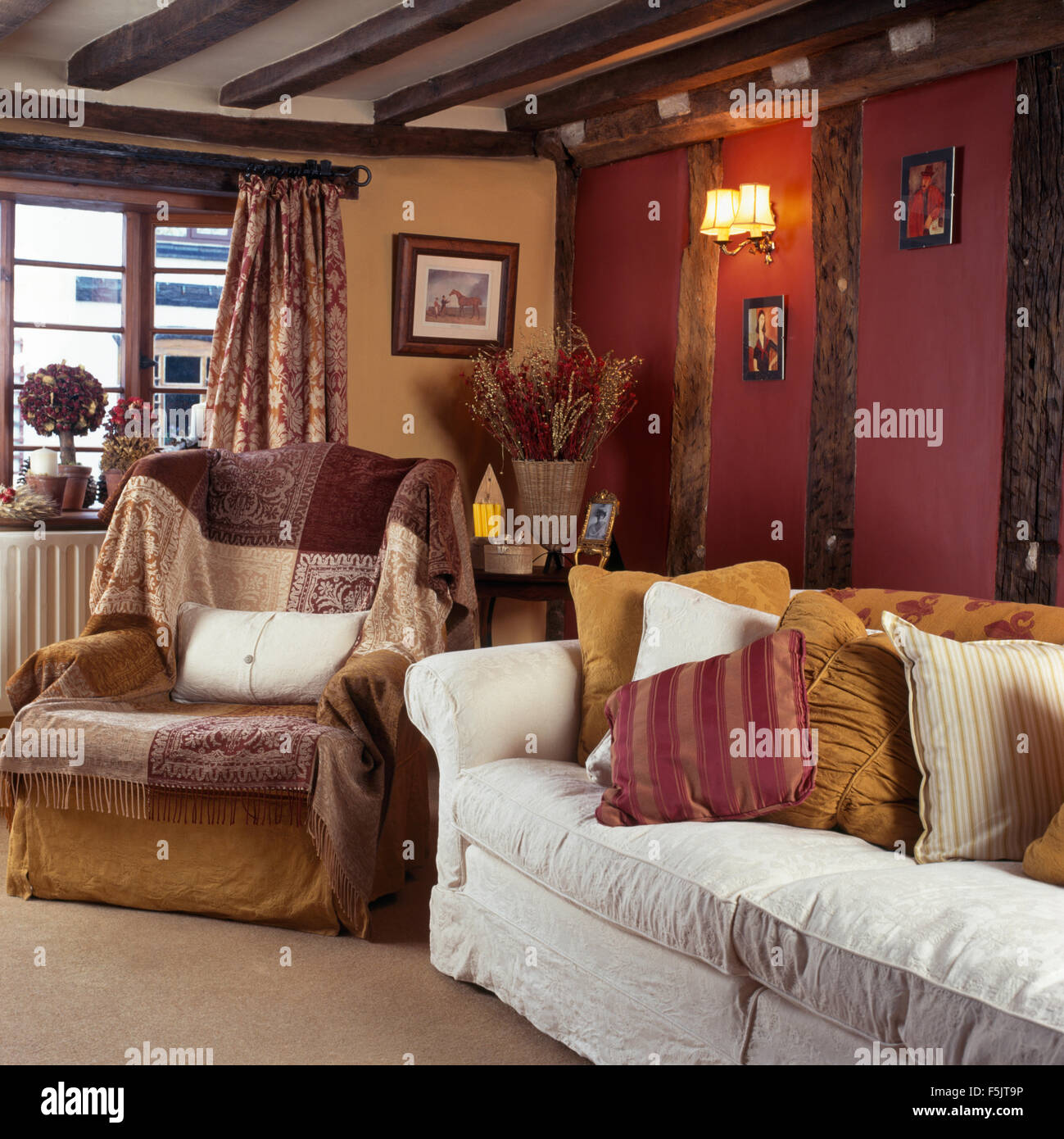 Patterned Throws On Armchair In Dark Nineties Cottage Living Room