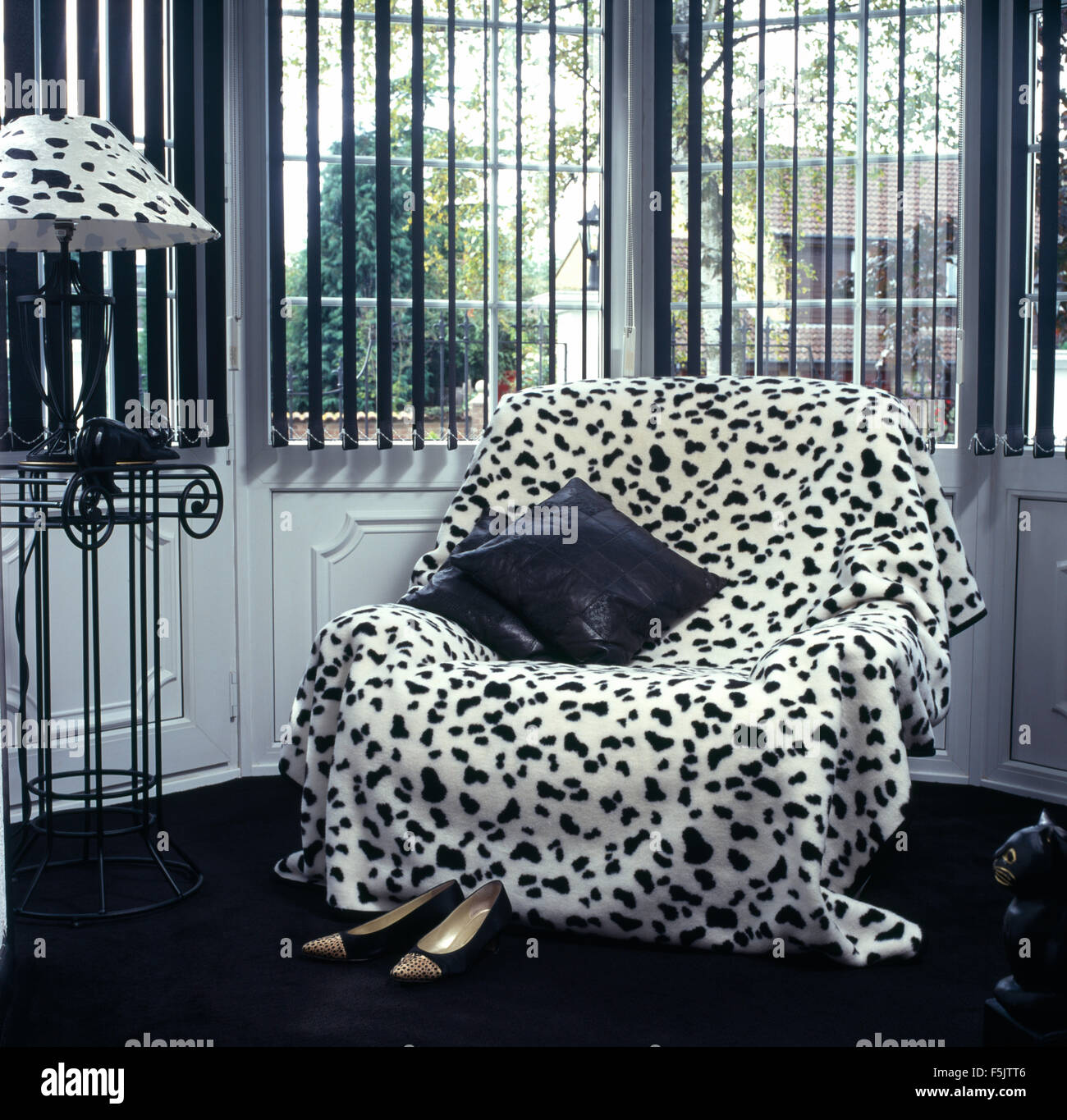 Dalmation Dog Printed Throw On Armchair In Front Of Window With Black  Venetian Blind In A Black+white Nineties Living Room