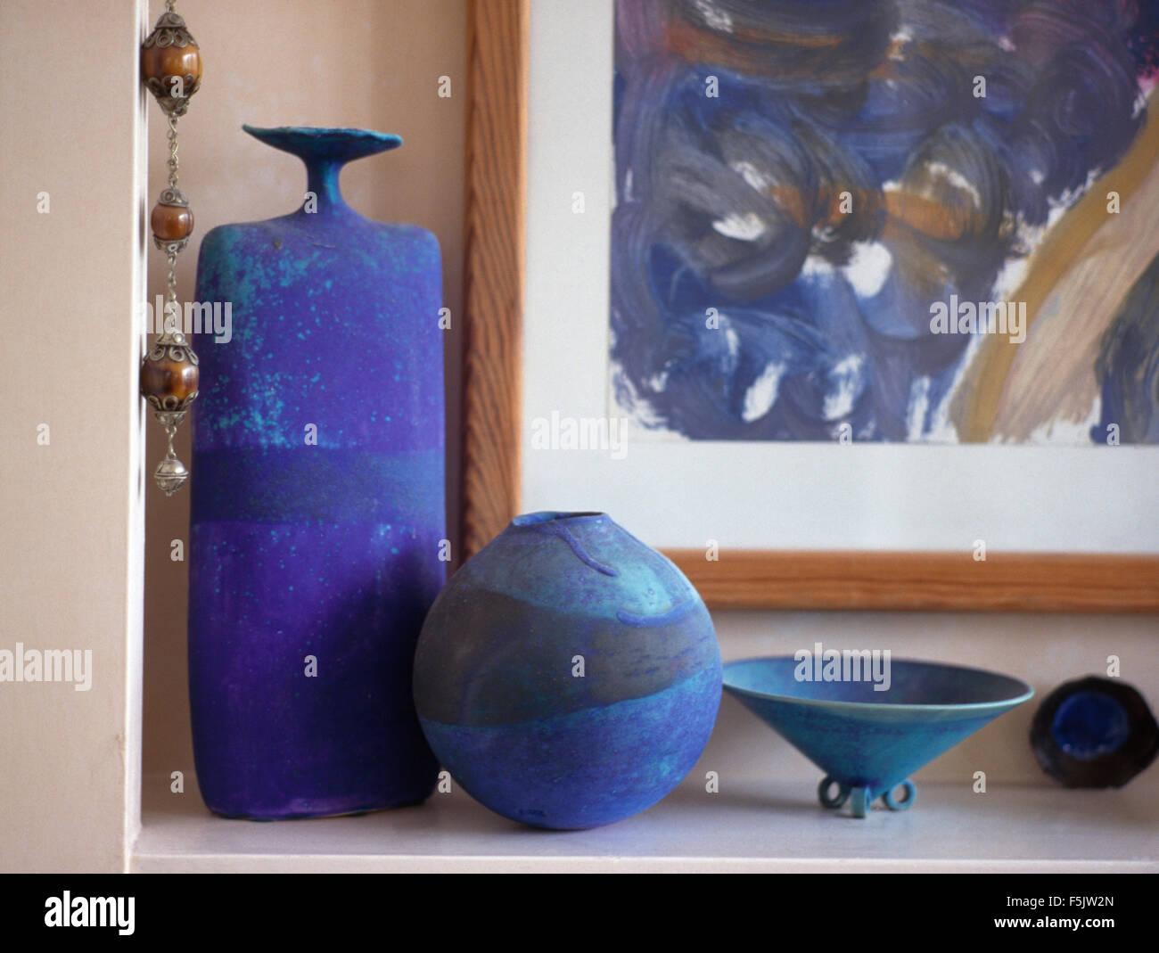 Close-up of three bright blue ceramic vases - Stock Image