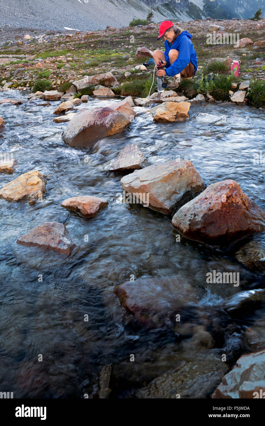 WASHINGTON - Pumping water for drinking from Upper Lyman Lake Basin in  Glacier Peak Wilderness area. - Stock Image