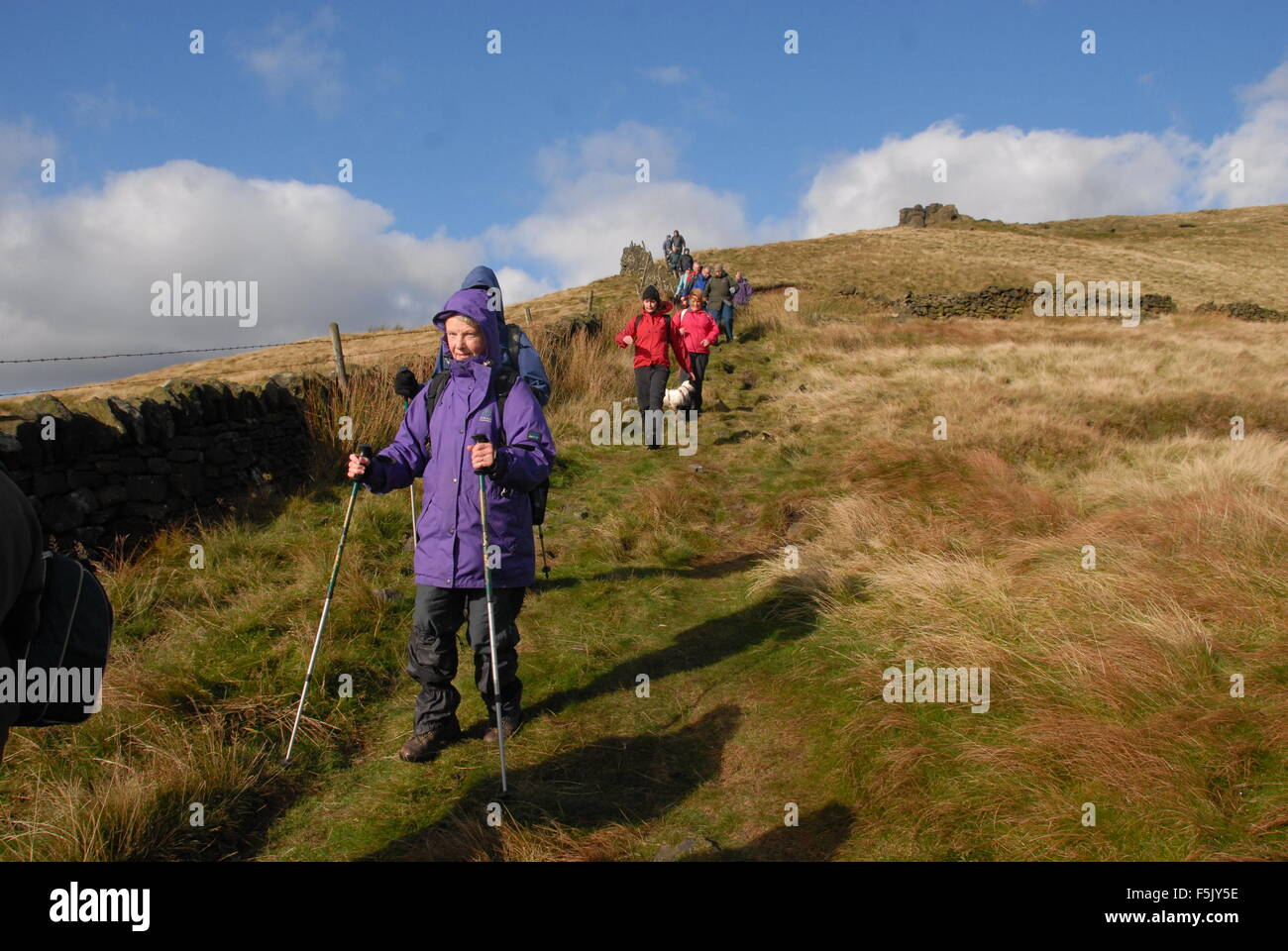 Walkers on Kinder Scout a high point on the Pennine Way and part of the Peak District above Manchester. - Stock Image