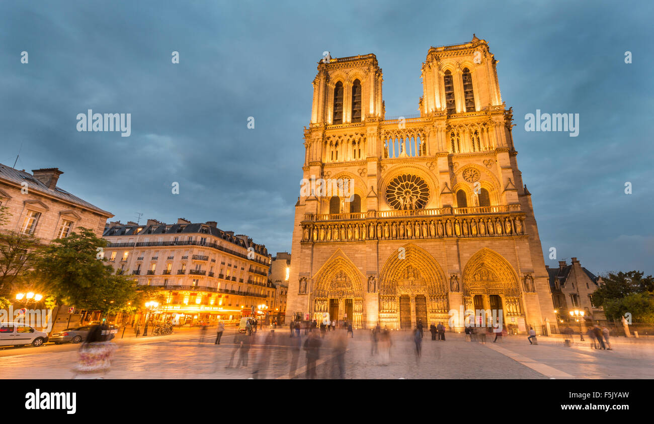 Notre Dame Cathedral at dusk, interior, western facade, Ile de la Cite, Paris, Region Ile-de-France, France - Stock Image