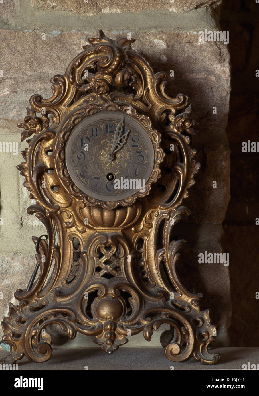 Close-up of a vintage metalwork French style clock - Stock Image