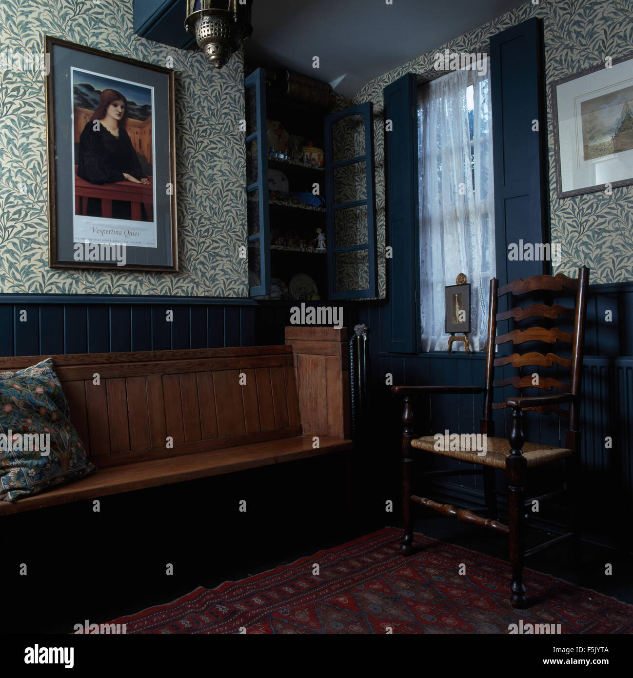 Wooden Settle And Ladder Back Chair In An Arts Crafts Style Room Stock Photo Alamy