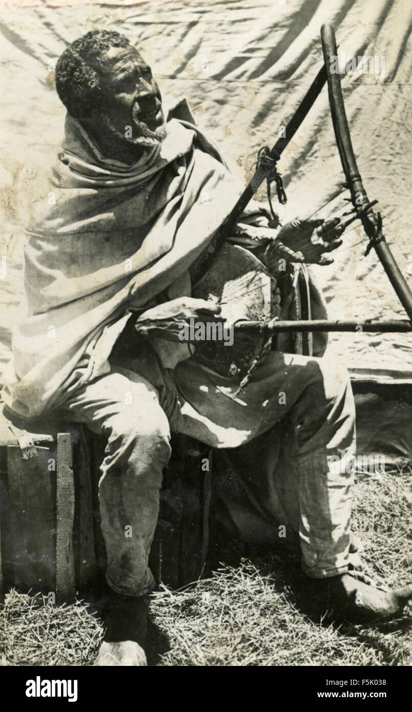 A man playing a stringed musical instrument , East Africa - Stock Image