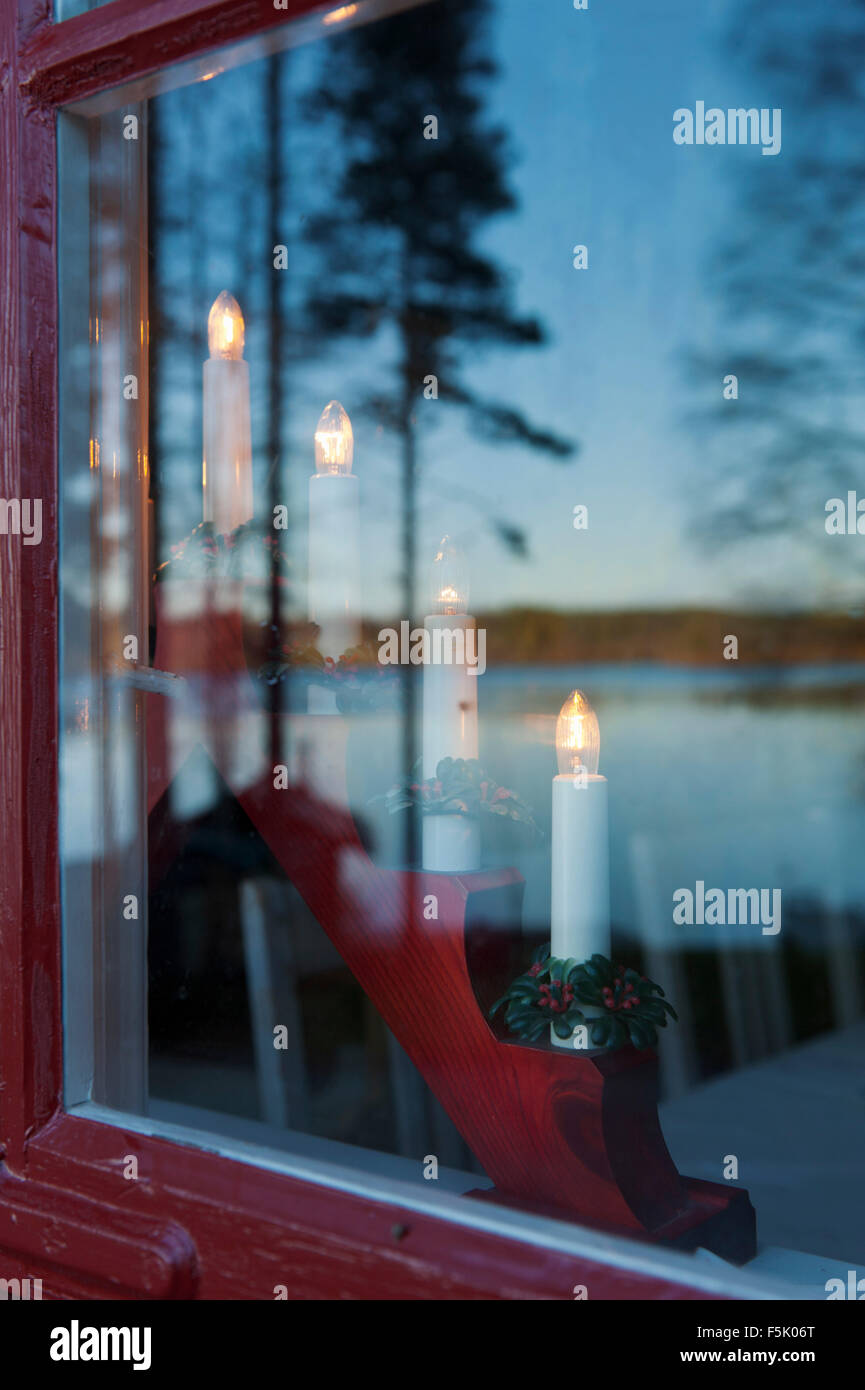 Advent lights in window - Stock Image
