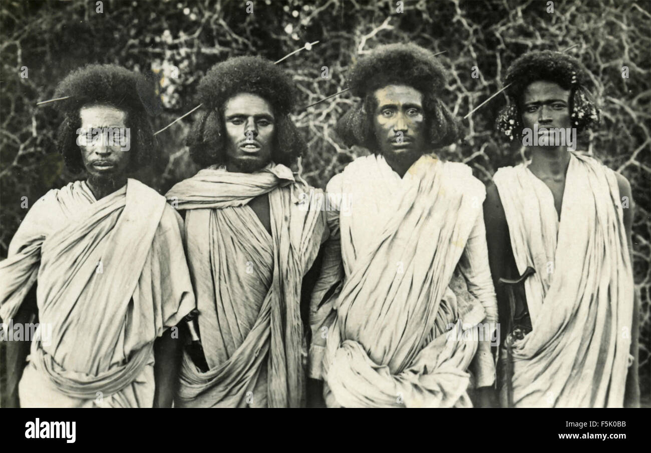 Four young Africans with traditional clothes , East Africa - Stock Image