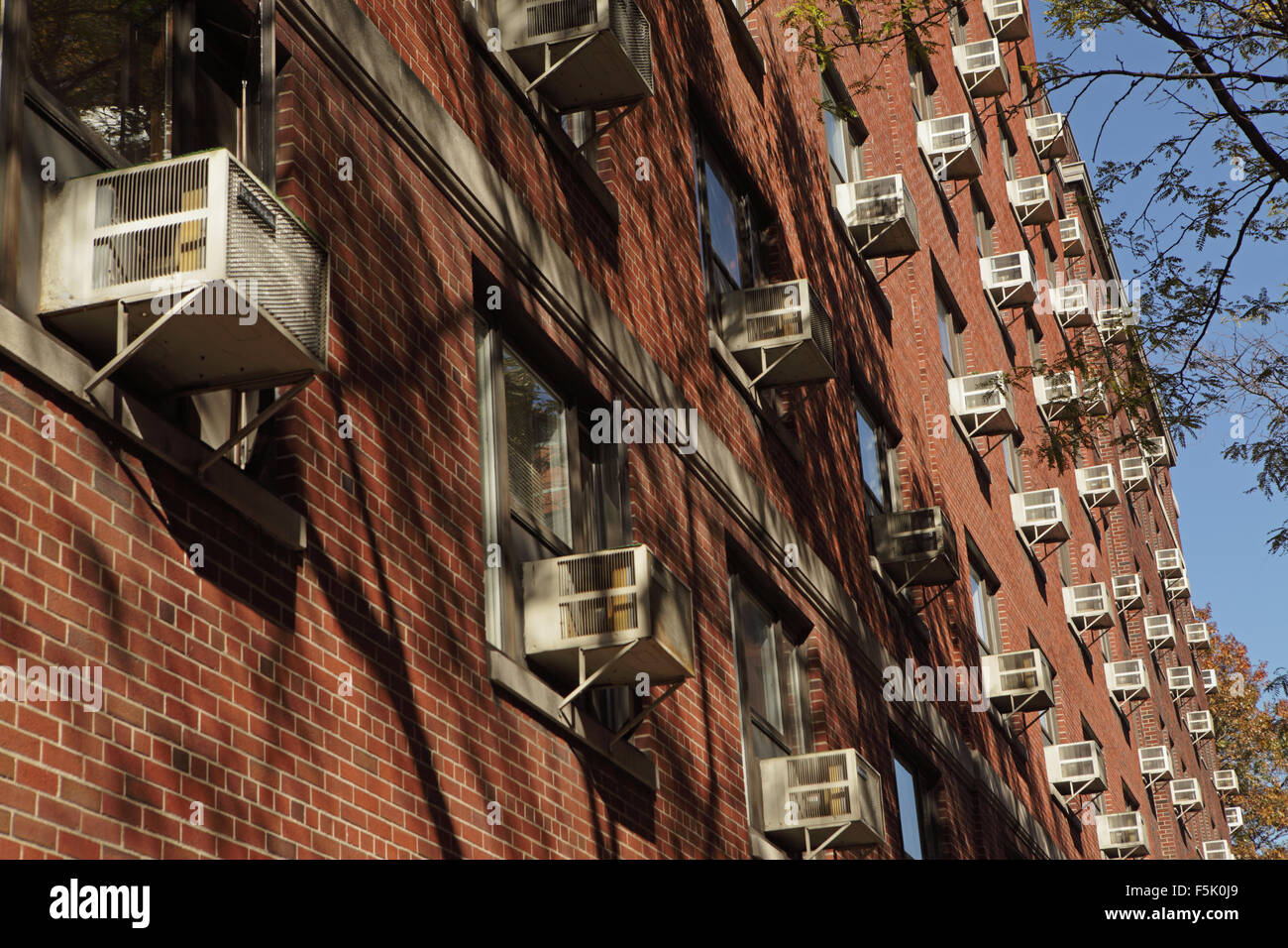 Hundreds of window air conditioning units in a Brooklyn building - Stock Image