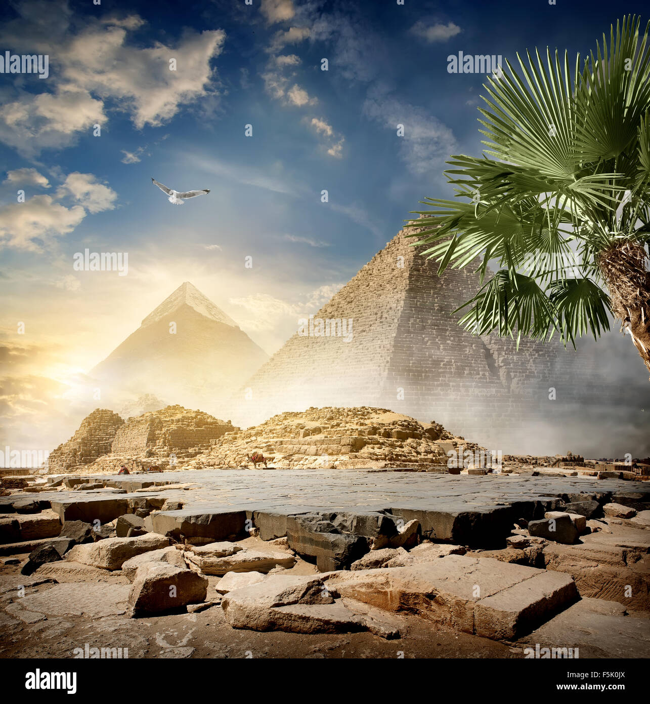 Fog around pyramids in desert at sunrise - Stock Image