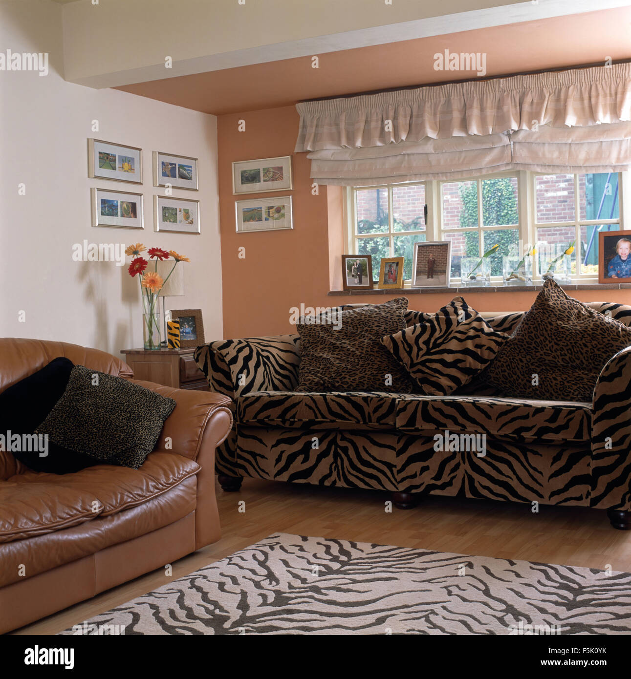 Frilled Blind Above Tiger Print Sofa And Matching Rug In