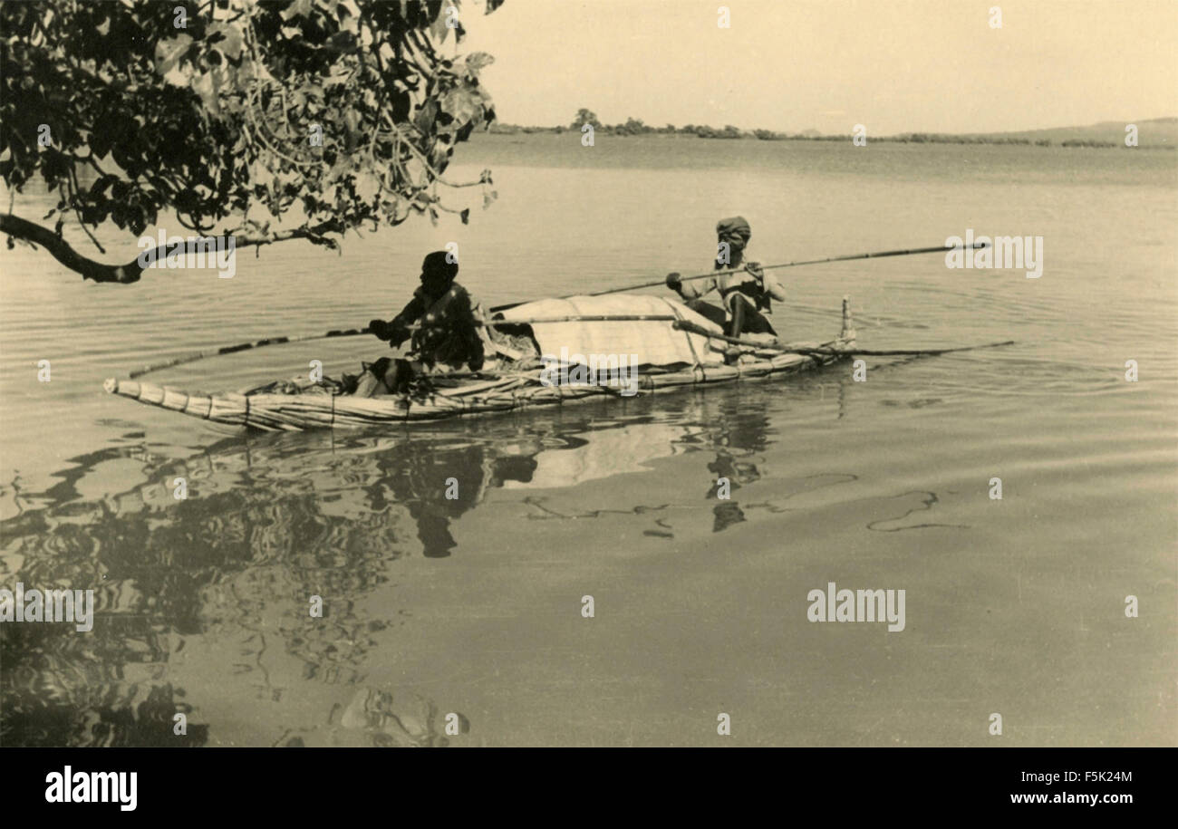 Two Africans on a canoe - Stock Image