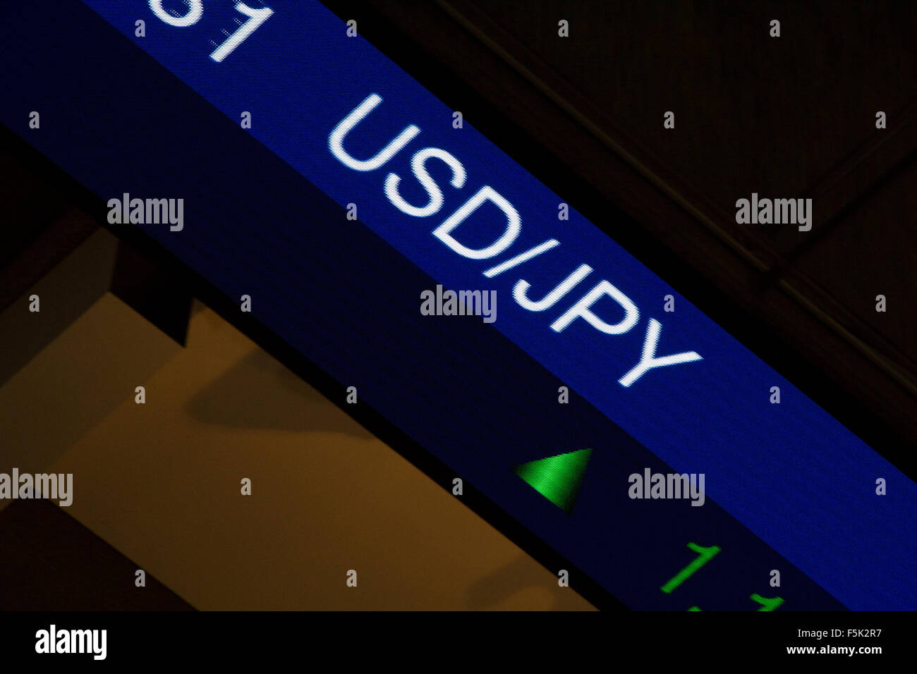 Display stock market charts on blue neon line with blurred office background.American / Japanese currency rate - Stock Image