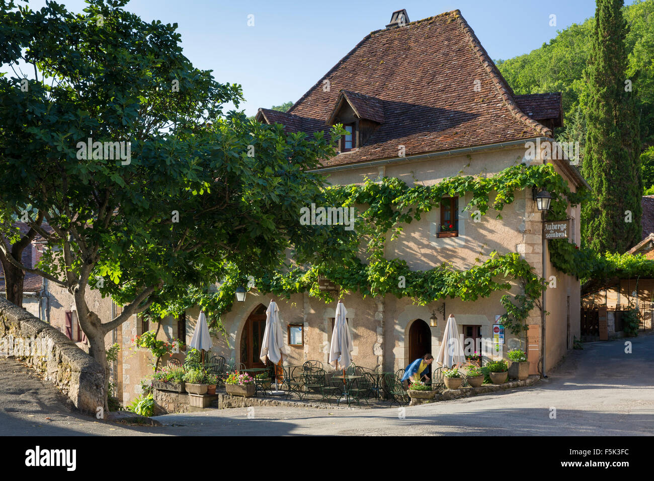 Getting ready to serve breakfast at the cafe, Saint-Cirq-Lapopie, Lot Valley, Midi-Pyrenees, France - Stock Image