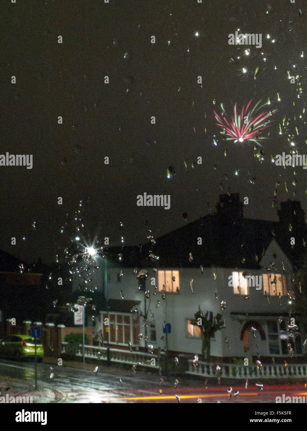 Rained off. Firework night looking out through a rain speckled  window. - Stock Image