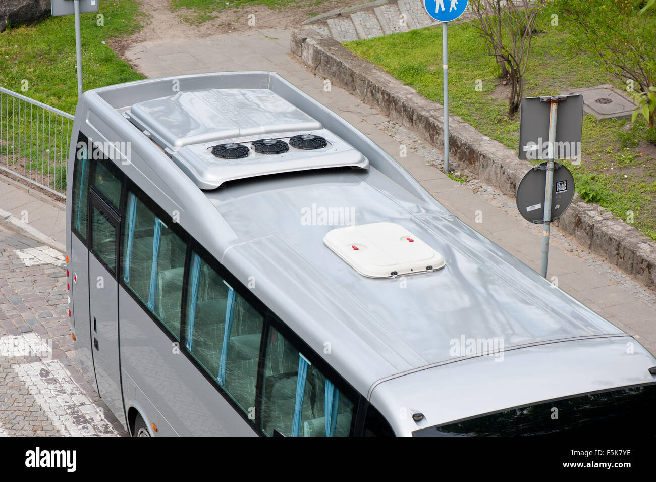 Tourist bus rooftop air conditioner unit, conform heat control element, cooling appliance installed on the coach - Stock Image