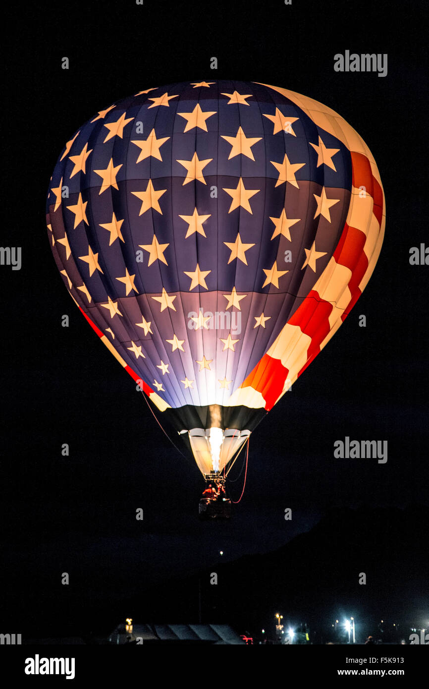 Illuminated Stars and Stripes hot air balloon flying Dawn Patrol, Albuquerque International Balloon Fiesta, New - Stock Image