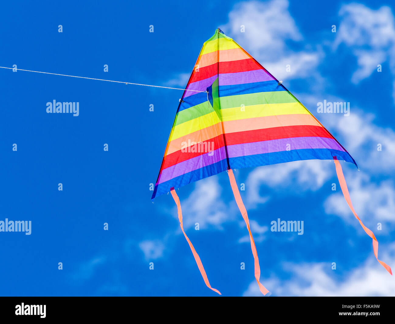 Wind kite flying in a blue sky - Stock Image