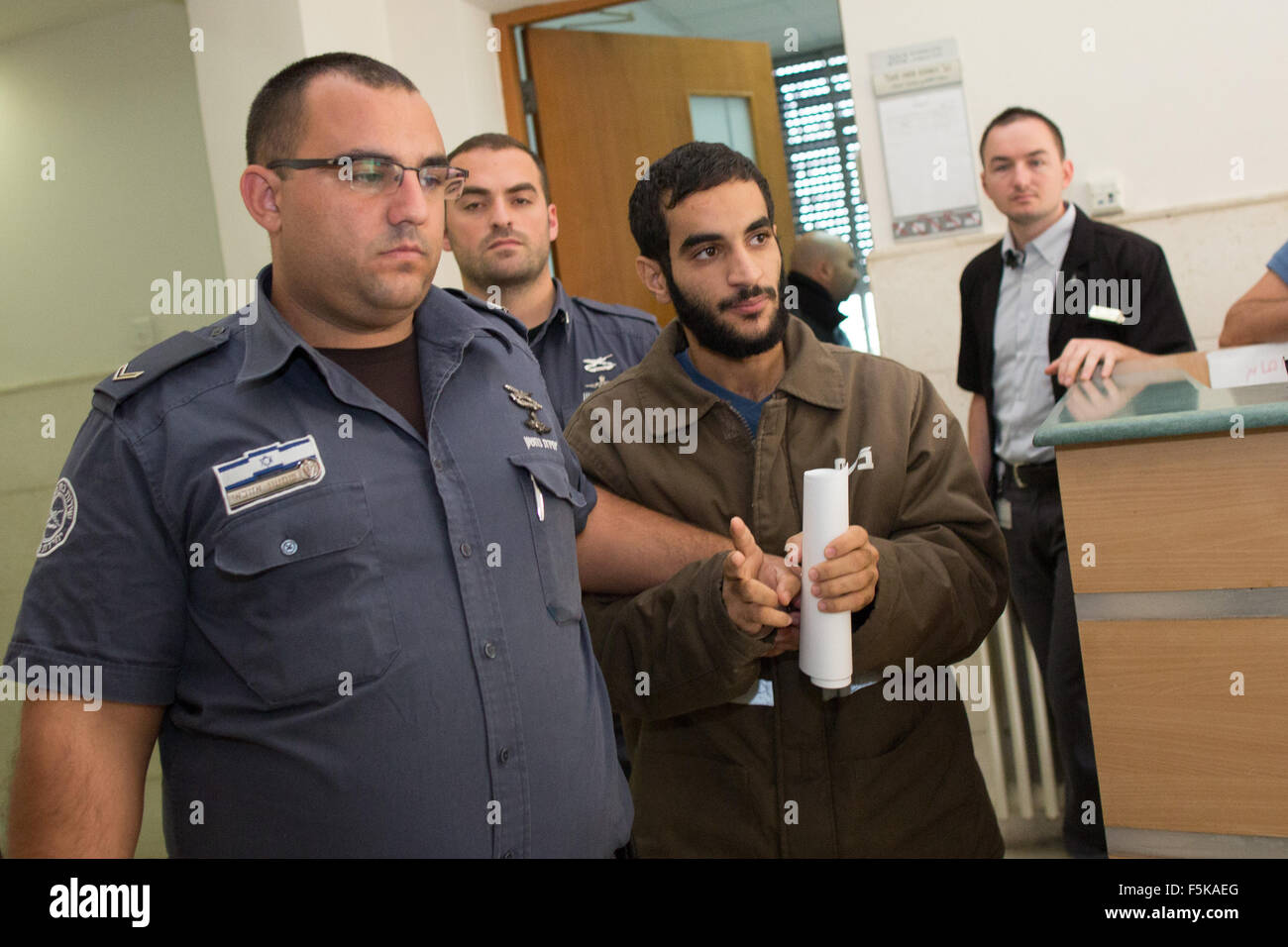 (151105) -- JERUSALEM, Nov. 5, 2015 (Xinhua) -- Abed al-Aziz Meri, 21, is escorted by Israeli prison officers at Stock Photo