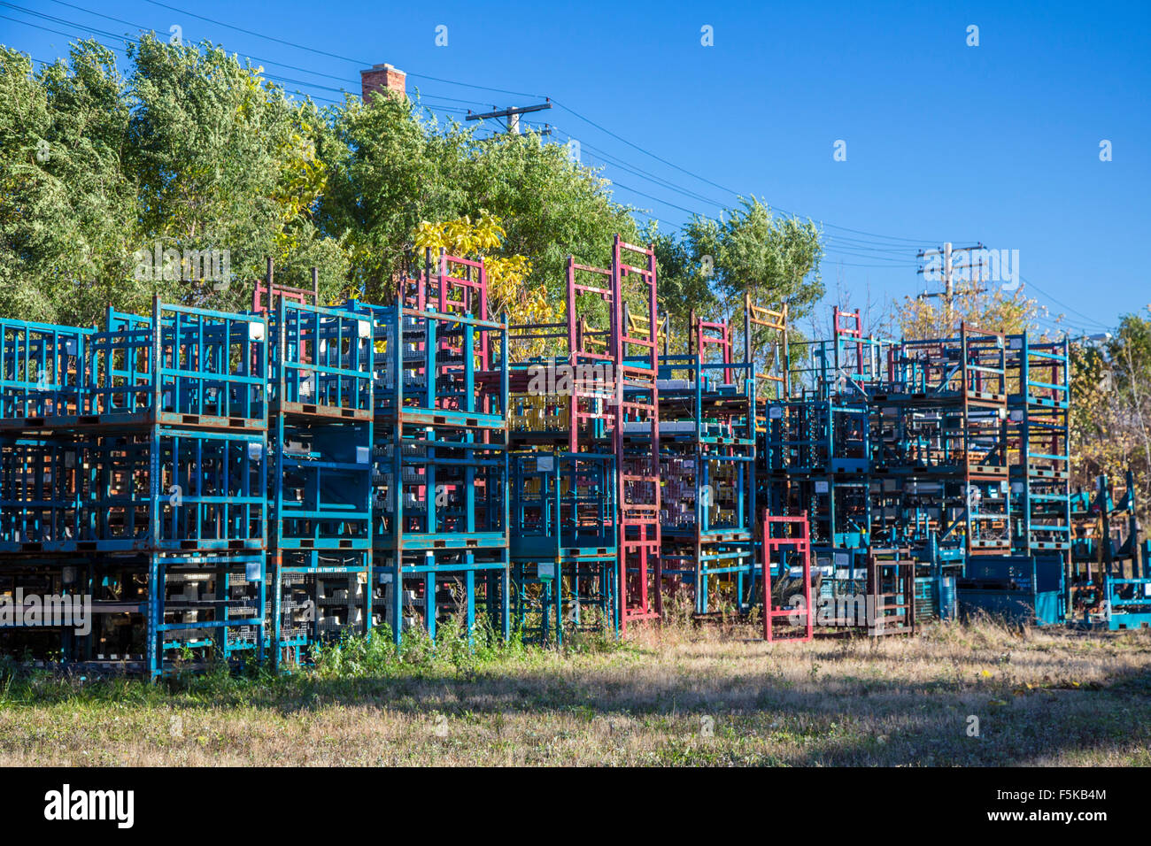 Detroit, Michigan - Shipping racks for auto parts abandoned on the site of a former industrial facility. - Stock Image