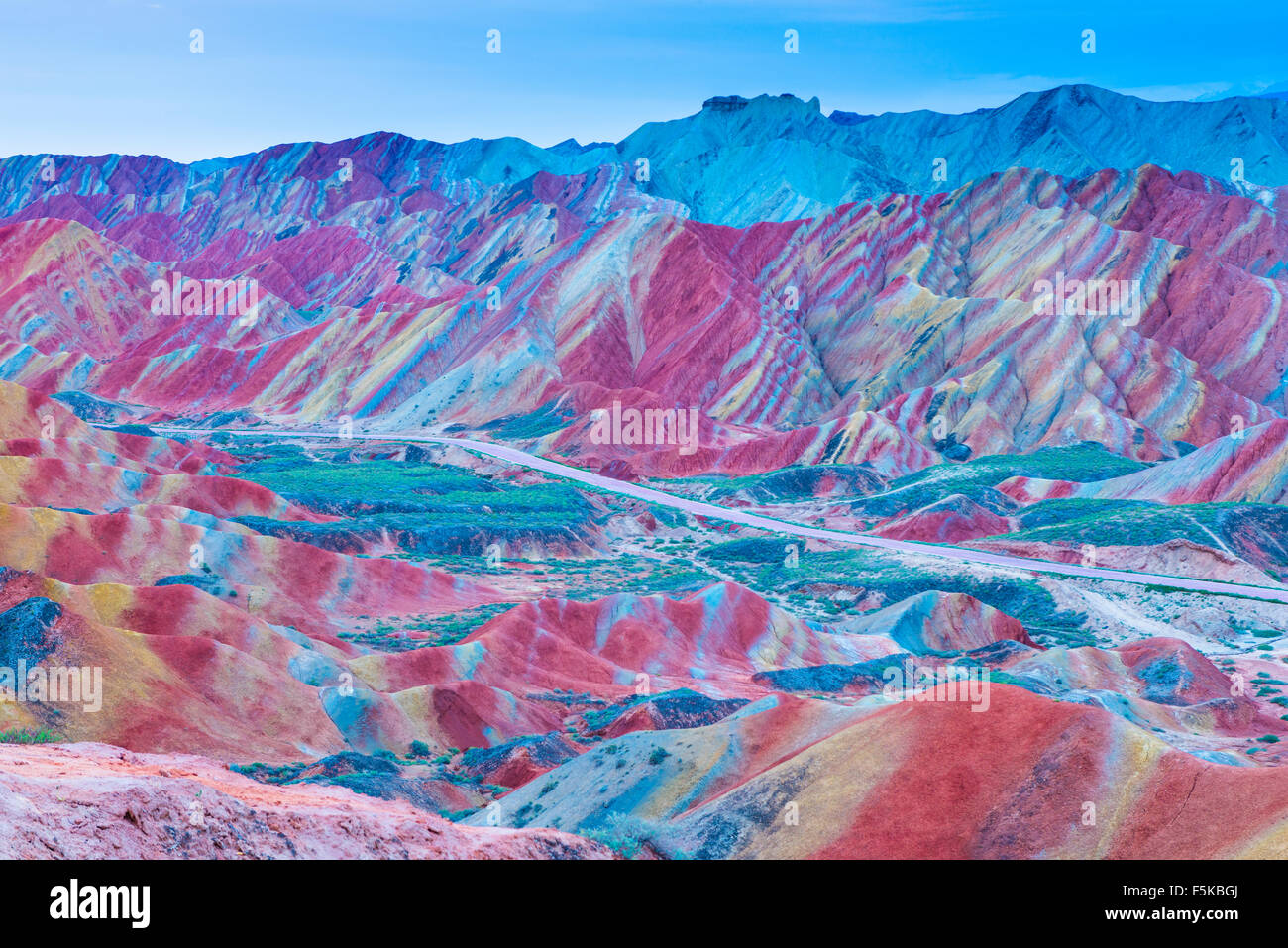 Colorful forms at Zhanhye Danxie Geo Park, China  Gansu Province, Ballands eroded in muliple colors - Stock Image