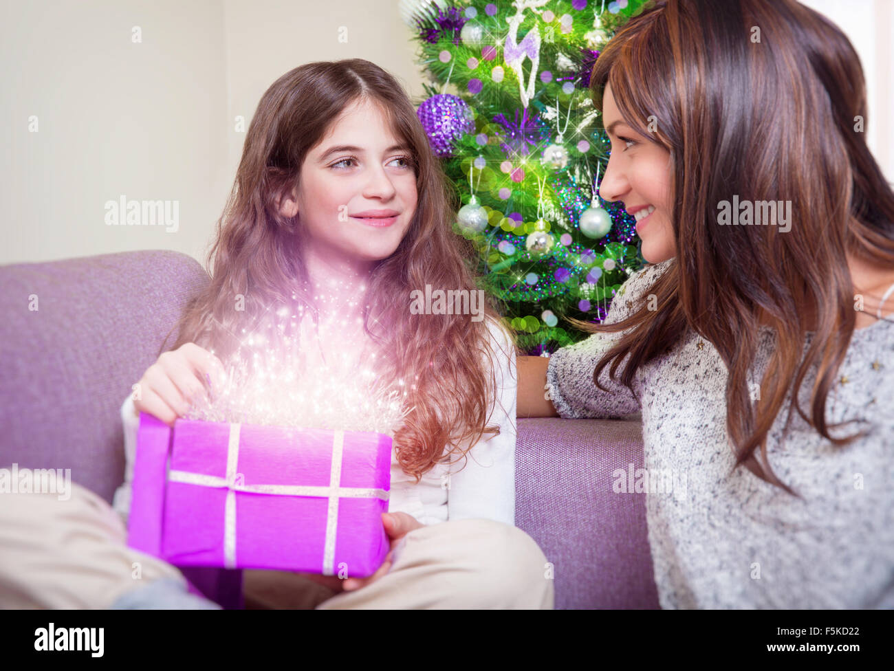 Cute teen girl receive gift from her beautiful young ...