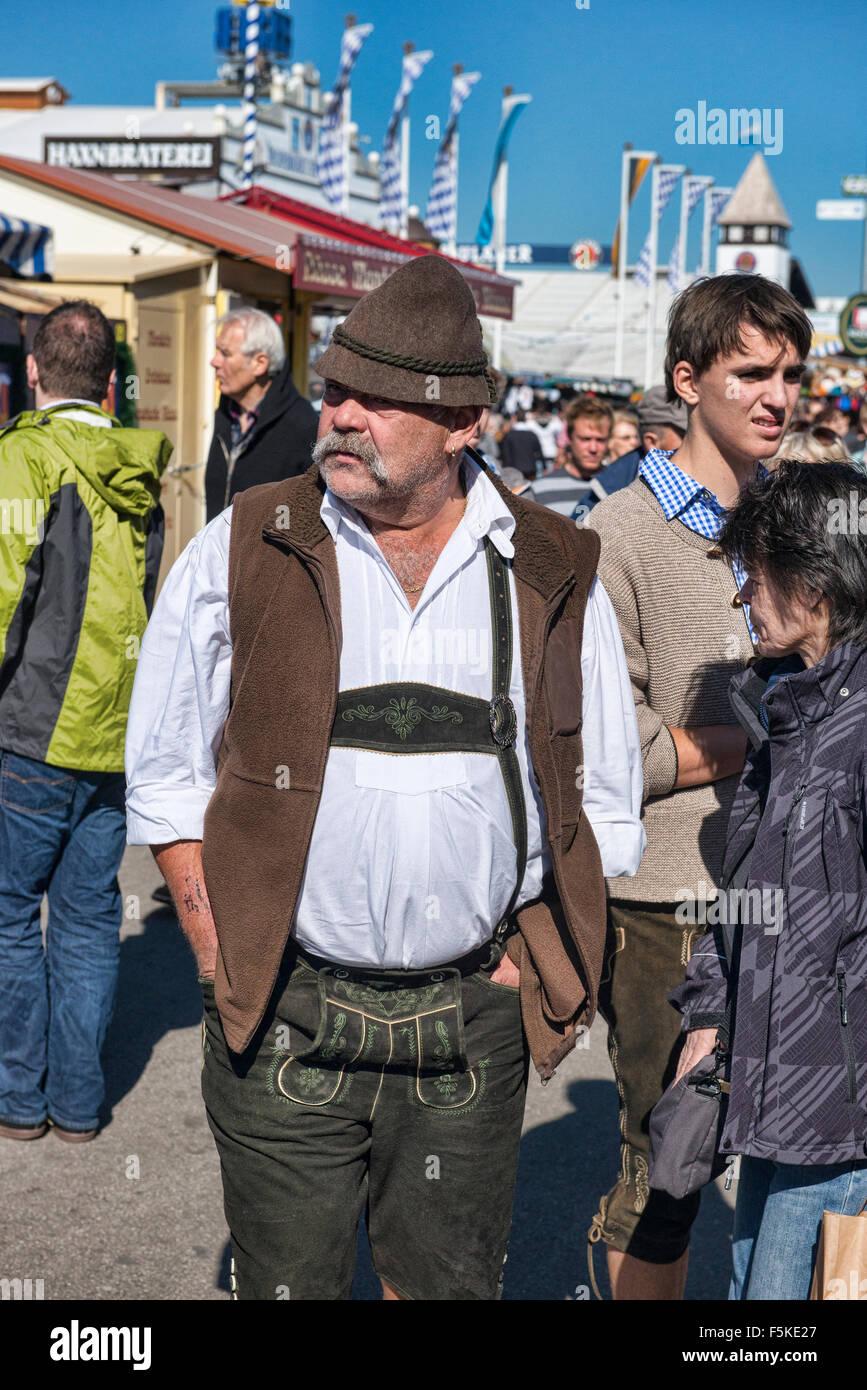 Guy in lederhosen at Oktoberfest in Munich, Germany - Stock Image