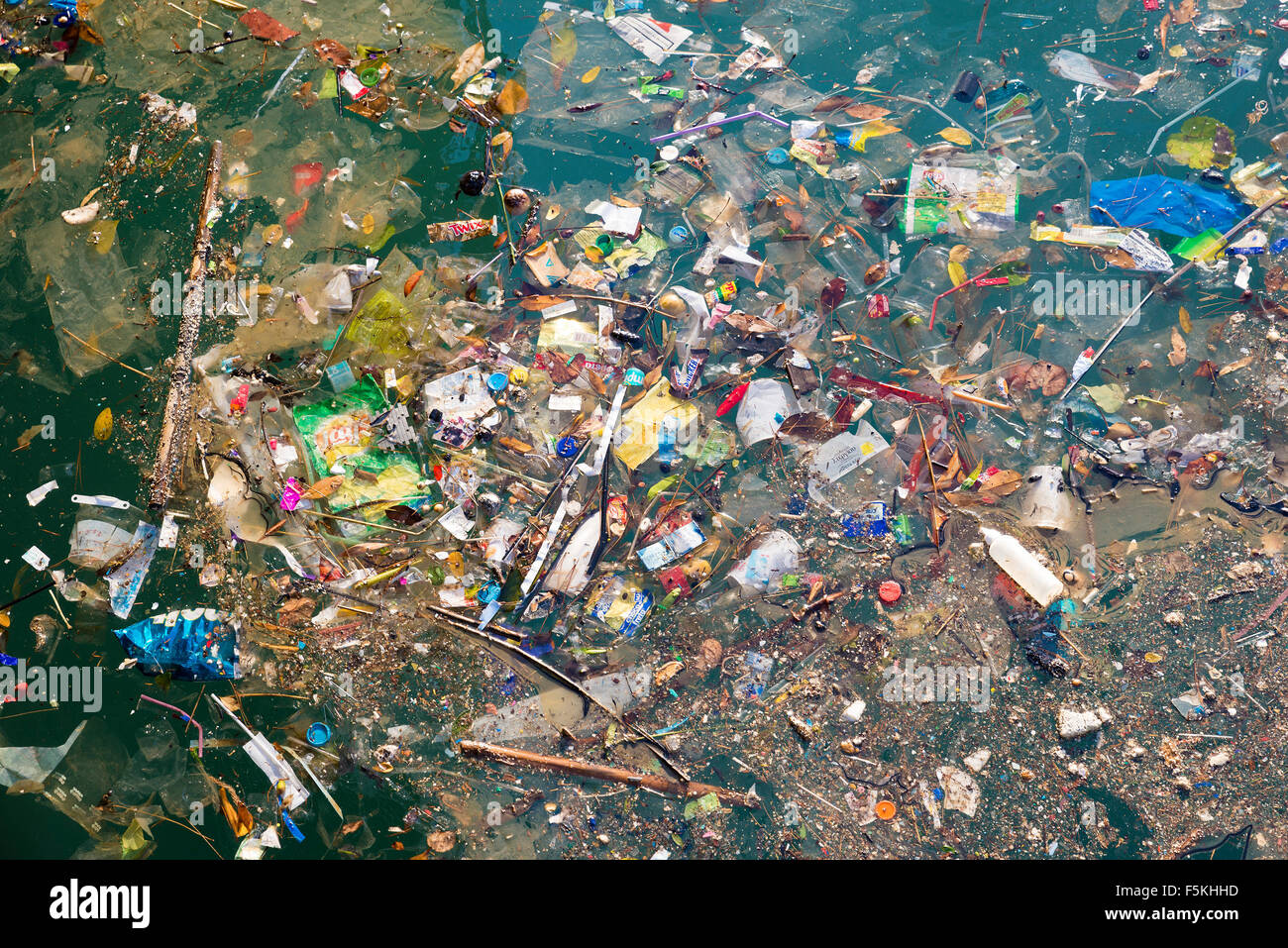 ATHENS, GREECE - OCTOBER 25, 2015: Port of Piraeus, a large amount of trash polluting the wate - Stock Image